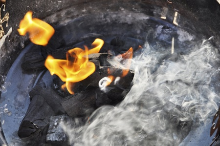 Preparing a barbecue, charcoal burning and smoke Stock Photo - 13039035