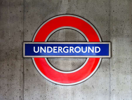 London, UK - March 12, 2012: London underground sign on a concrete wall