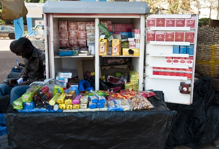 bamako: Bamako, Mali - February 15, 2012: Tobacco and snacks stand in a street of Bamako, Mali