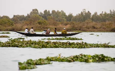 bamako: Bamako, Mali - February 15, 2012: Bozo fishermen on the river Niger outside Bamako, Mali Editorial