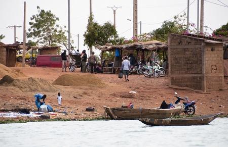 bamako: Bamako, Mali - February 15, 2012: Bozo village on the river Niger outside Bamako, Mali