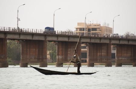 bamako: Bamako, Mali - February 15, 2012: Bozo fishermen on the river Niger in Bamako