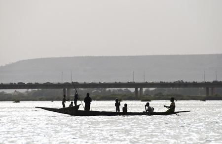 mali: Bamako, Mali - February 15, 2012: Bozo fishermen on the river Niger in Bamako