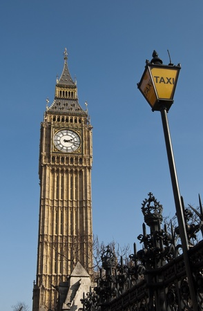 taxi famous building: The Clock Tower in London and a taxi station sign