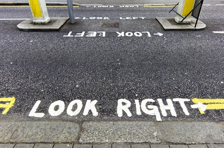 Look right warning painted on the tarmac in London, England, UK photo