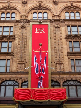 LONDON, UK, Tuesday 15, 2012. In the early morning workers put the last touch to the special Queens Diamond Jubilee decoration on Harrods facade.