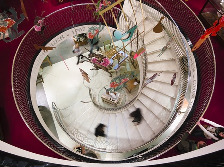 view of a staircase in a shop: London, UK - April 15, 2012: Spiral stairway in Fortnum & Mason department store, London, England, UK