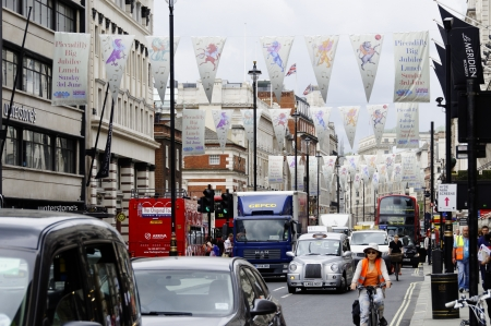 piccadilly: LONDON, UK, Friday June 1, 2012. Flags on Piccadilly to advertise the Piccadilly Big Jubilee Lunch which will be held on Sunday June 3, 2012. Editorial