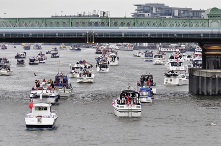 putney: LONDON, UK, Sunday June 3, 2012. Hundred of boats muster on the river Thames in Putney (west London) for the Thames Diamond Jubilee Pageant.