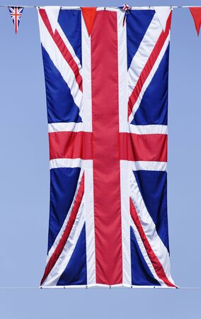 Union Jack flag, blue sky background photo