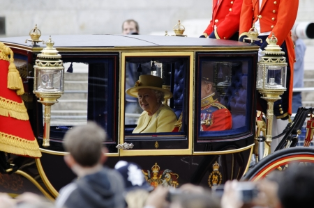 LONDON, UK - June 16: Queen Elizabeth II and the Duke of Edinburgh during Trooping the Colour ceremony on the Mall and at Buckingham Palace, on June 16, 2012 in London. Trooping the Colour takes place every year in June to officialy celebrate the sovereig