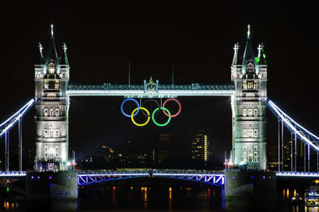 LONDON, UK - JULY 5, 2012: Olympic rings suspended on Tower Bridge in London, night photography.