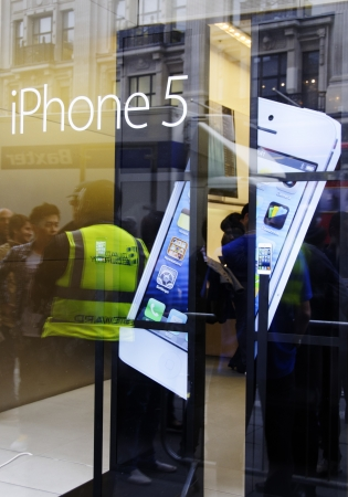 21: LONDON, UK, Friday September 21, 2012. The iPhone 5 goes on sale at the Apple Store on Regent Street. Editorial