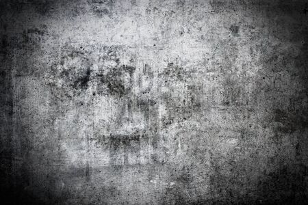 Dark and grungy concrete wall background with vignette photo