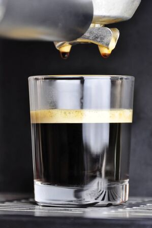 espresso machine: An espresso cafe served in a glass Stock Photo