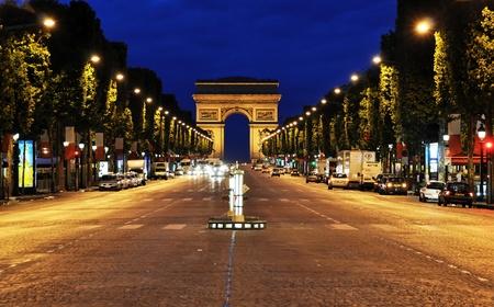 De Champs-Elysees bij nacht, Parijs, Frankrijk