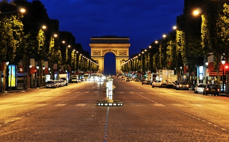 The Champs-Elysees avenue at night, Paris, France