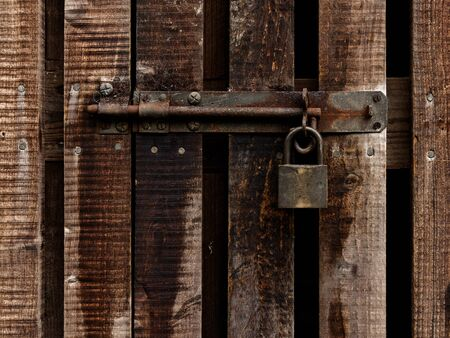 Vintage lock and padlock on a wooden door photo