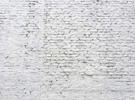 Cracked white brick wall background photo