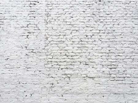 Gebarsten witte bakstenen muur achtergrond Stockfoto