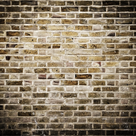 Grunge brick wall, square photograph with vignette photo