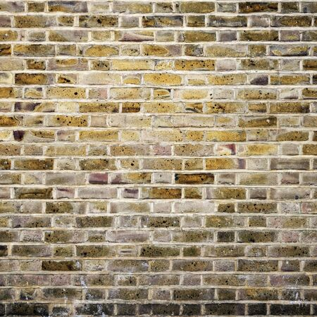Square brick wall texture and background photo