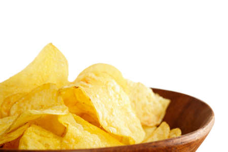 Crisps in a wooden bowl on white background