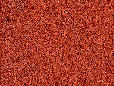 road surface: A red macadam pavement texture