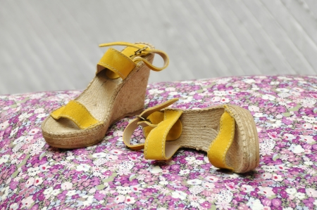 basque woman: A pair of women espadrilles, high heeled and yellow suede Stock Photo