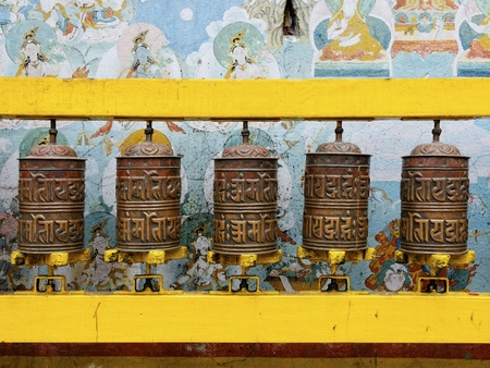 Prayer wheels at Bodhnath stupa in Kathmandu, Nepal photo
