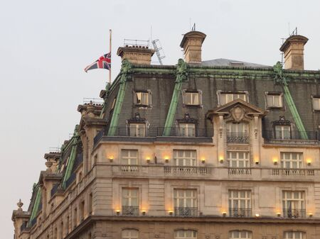 thatcher: LONDON - UK, April 08: Union Jack flag at half mast at the Ritz hotel where Margaret Thatcher has died from a stroke on April 8, 2013 in London.