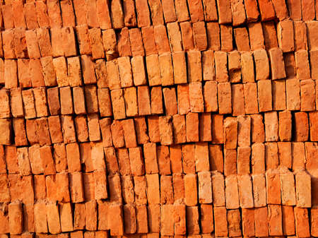 sienna: Brick stack, construction material background Stock Photo