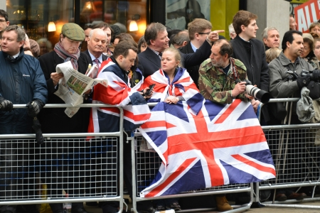 London, UK. April 17th, 2013. The crowd waits for Baroness Thatcher funeral procession on Ludgate Hill.