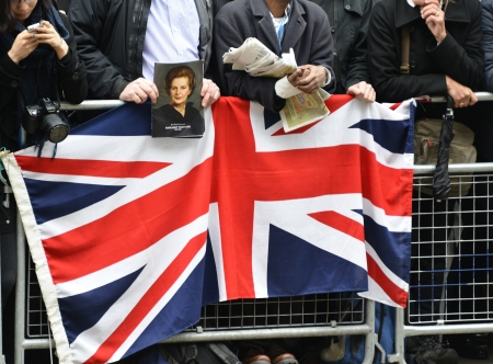 London, UK. April 17th, 2013. Man holding a portrait of Baroness Thatcher  along the Procession route.