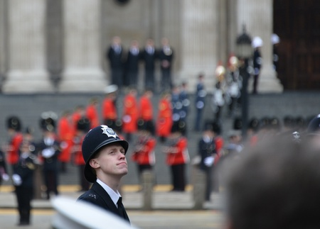 thatcher: London, UK. April 17th, 2013. Policeman lining Baroness Thatcher procession route on Ludgate Hill.