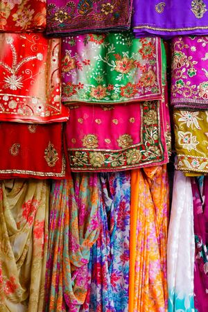 Colorful clothes and saris on display photo