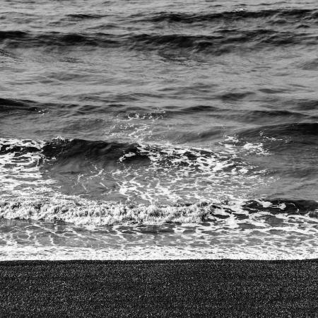 brighton beach: Sea waves and pebble beach in black and white Stock Photo