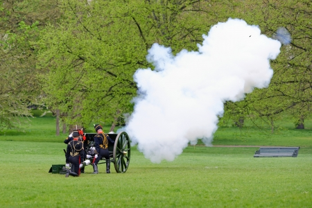 salutes: London, UK. May 8th, 2013. The Royal Artillery in Green Park is firing gun salutes for the State Opening of Parliament. Editorial
