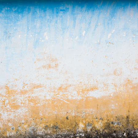 Dilapidated beige and blue wall texture, grungy background photo