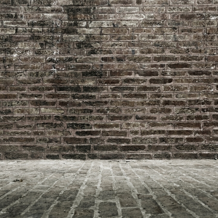 Grungy brick wall and floor photo