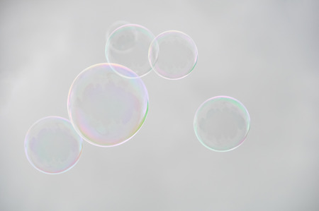 wafting: Soap bubbles against a cloudy sky background