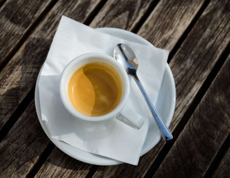 Espresso cup on a wooden table photo