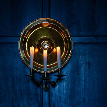 Candles and blue wooden wall background Stock Photo - 24906429