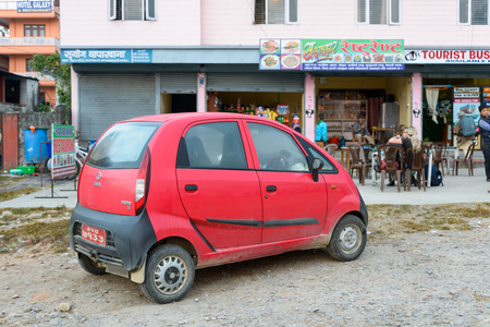 cheapest: Pokhara, Nepal - NOVEMBER 21, 2013  Red Tata Nano  The Tata Nano is the cheapest car in the world with a price starting at around  2000 in India