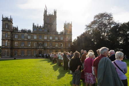 NEWBURY, UK - CIRCA OCTOBER 2011  People  queuing to visit Highclere Castle which  is the main setting for the ITV period drama Downton Abbey
