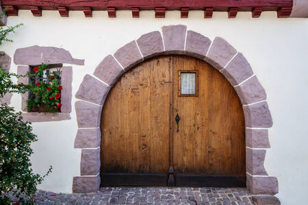 country house: Old wooden door in the French Basque Country