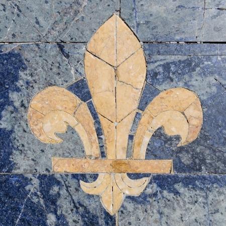 Stone fleur-de-lis ook wel fleur-de-lys Stockfoto
