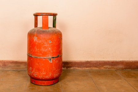 Red gas cylinder on pink cylinder Stock Photo - 25243203