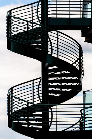 Spiral staircase and sky background