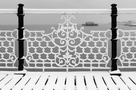 wrought iron: The Brighton west pier view from the Brighton pier in winter, black and white